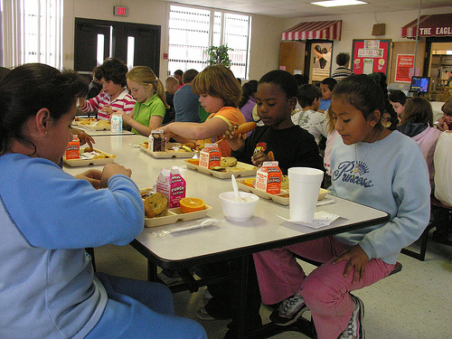 Kids in Nashville, Georgia, settle down to eat their school lunches. PHOTO: Flickr, Old Shoe Woman