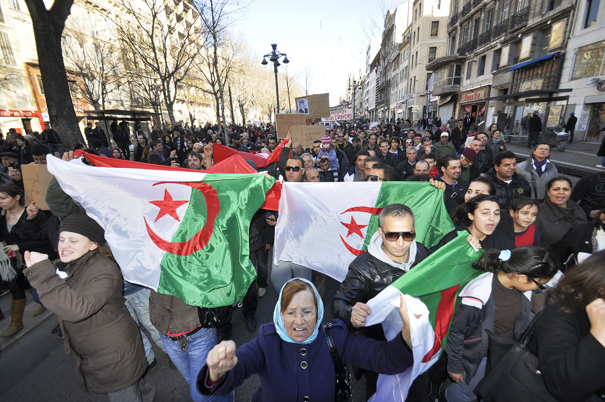 PHOTO: FLICKR/MARCOVDZ  A day after Tunisian President Ben Ali fled his country, Algerian demonstrators both young and old gather on the streets of France in support of democratic freedoms in Algeria.