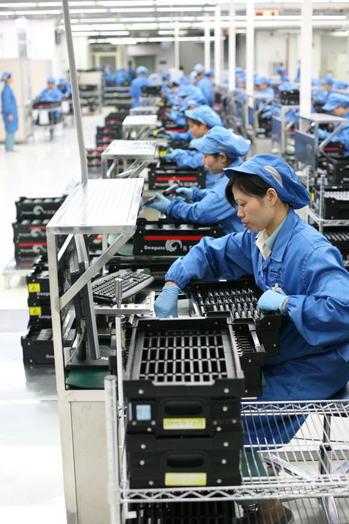 Workers test electronics at a factory in China. PHOTO: Flickr.com/Robert Scoble