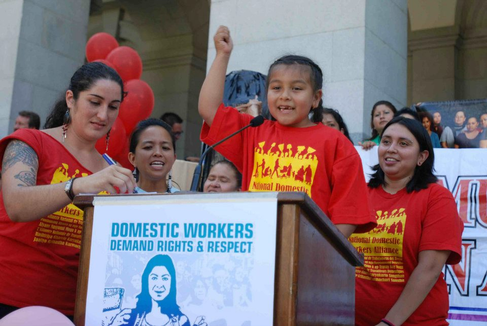 A kid speaks for the rights of domestic workers at an August 2012 rally in Sacramento, CA.