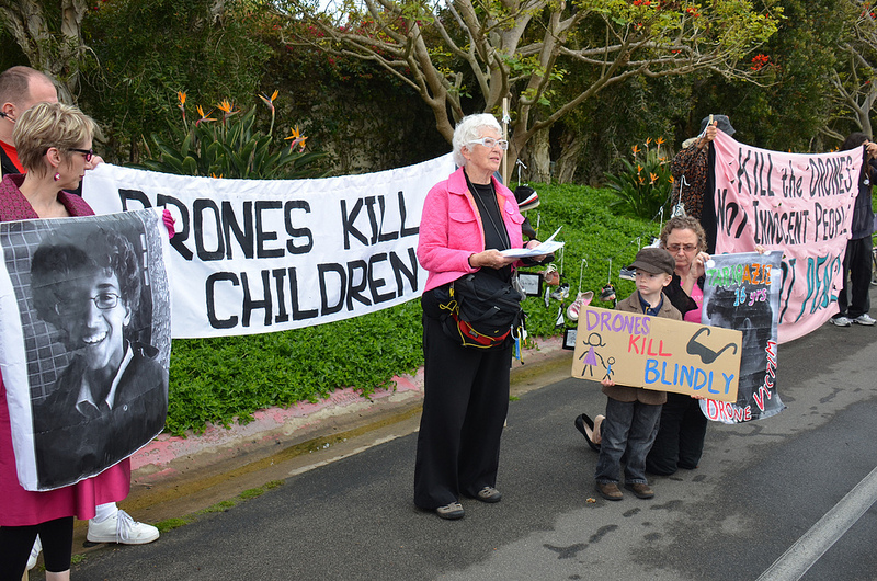 Code Pink protesting U.S. drone policy, with a photo of Abdulrahman al-Awlaki on the left. PHOTO: Steve Rhodes