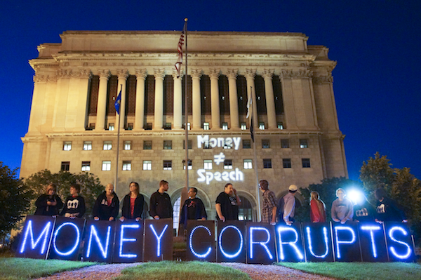 Protesters outside the Milwaukee County Courthouse demand that corporations' money should not influence politicians. In 2010, the U.S. Supreme Court ruled that corporations can donate unlimited funds to political campaigns. PHOTO: Joe Brusky